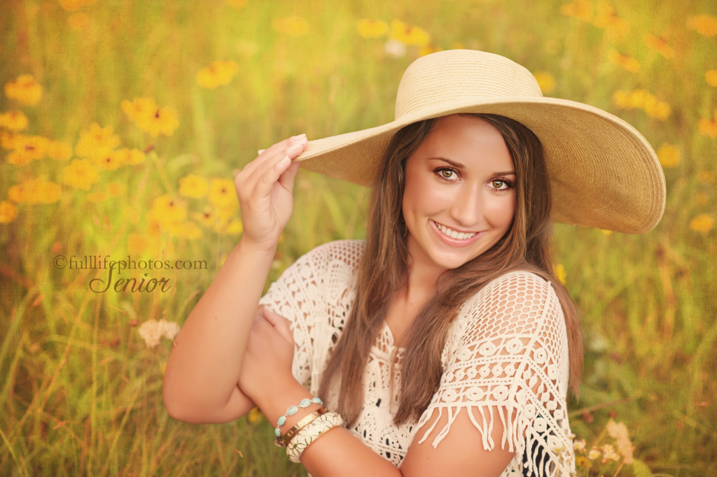 senior girl with hat in golden field