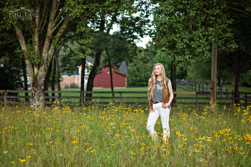 senior girl in flower field