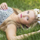 Senior girl laying in grass