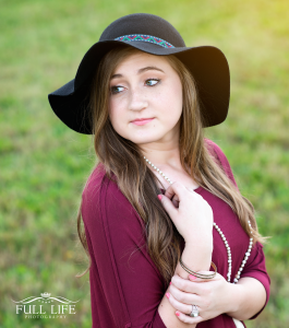 senior girl with hat